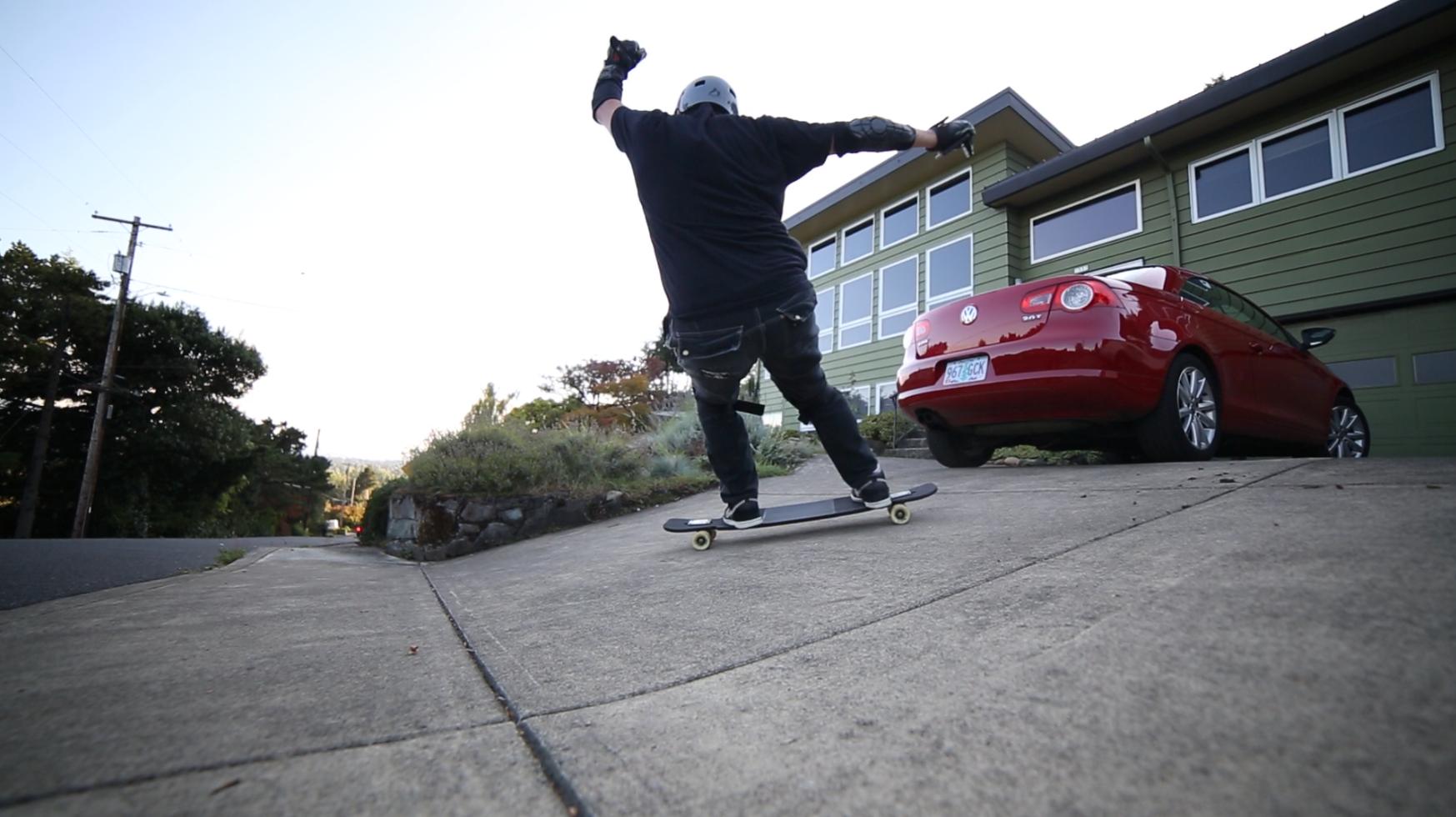Frontside slide onto a banked driveway.