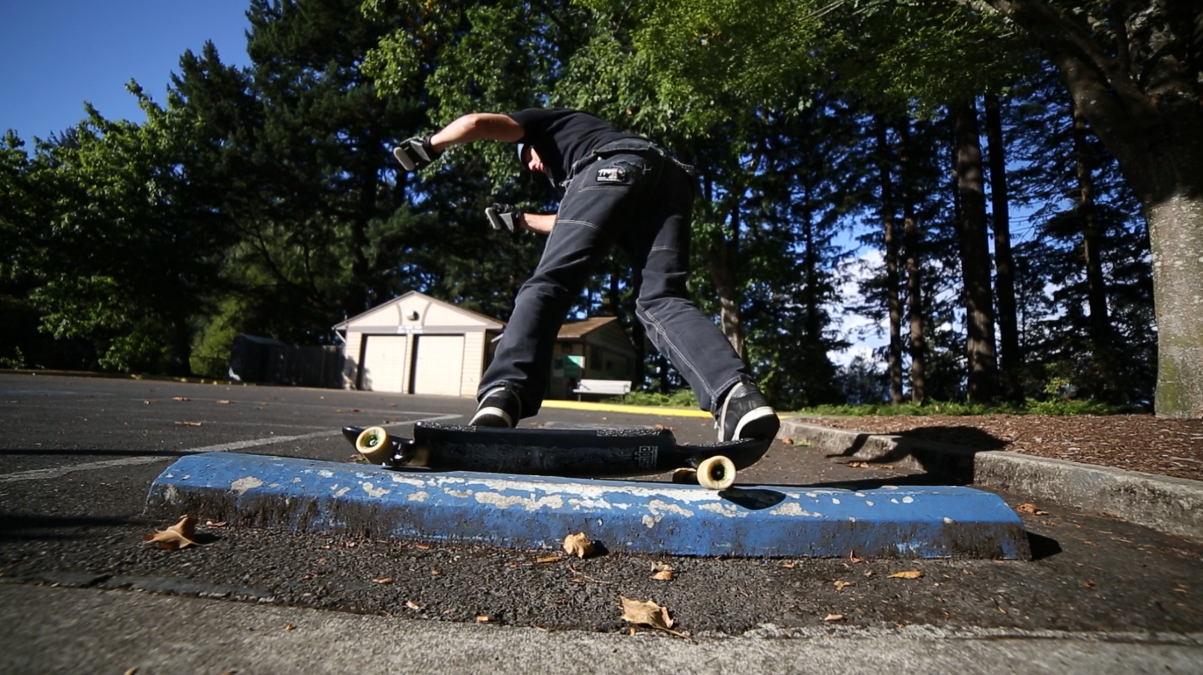 Backside slappy grind on a parking block.